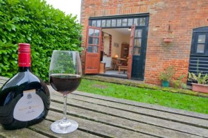 Relax with a glass of wine in the garden