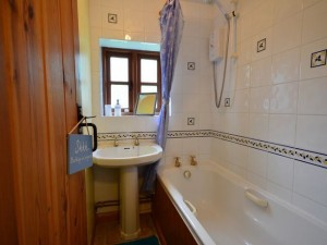 Bathroom with shower over the bath - There's a separate WC